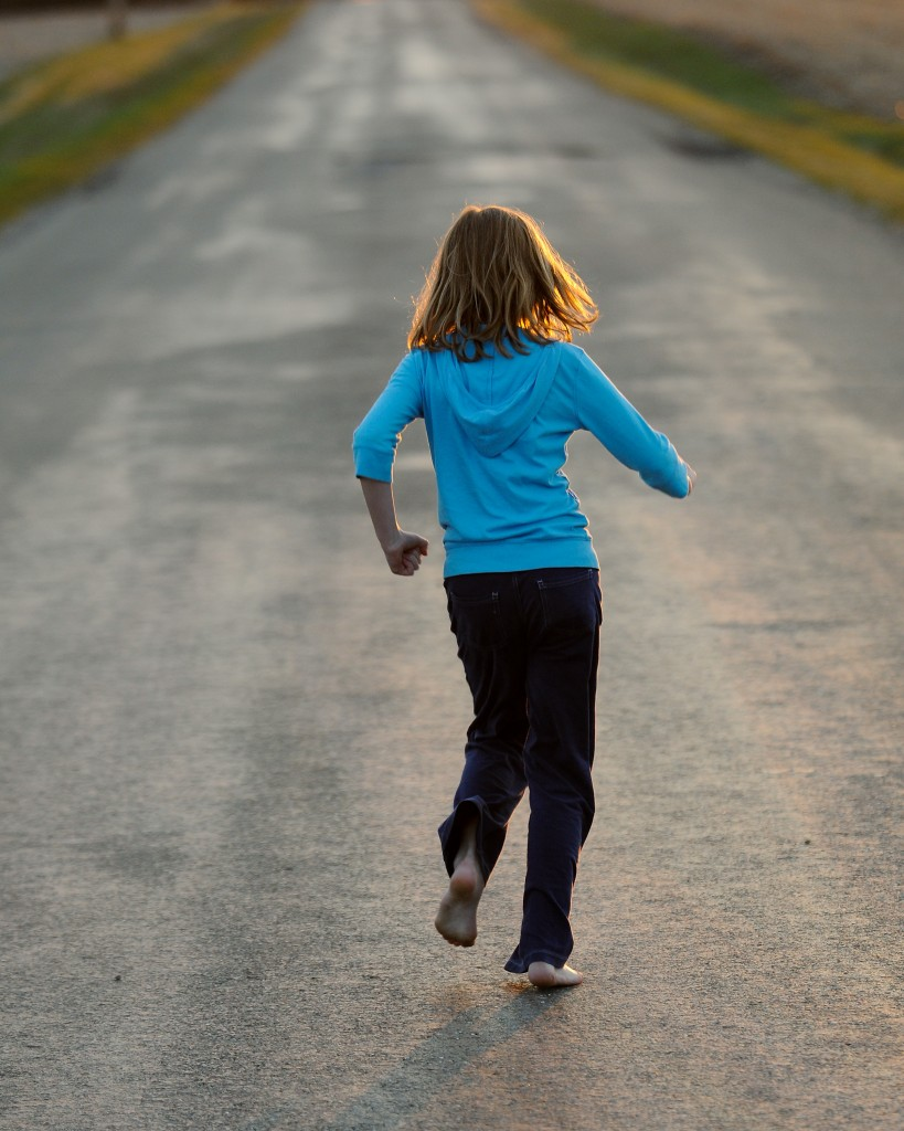 Girl running down road